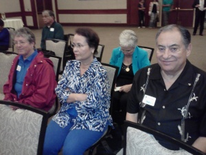 Sala Ponnech,Lulac vice President, Yolanda Esquivel, Lulac Health Fair Chairman and member of Credential Committee and Gilberto Esquivel President of Riverside Council 3190 await the start of the business meeting of the California State Coinvention