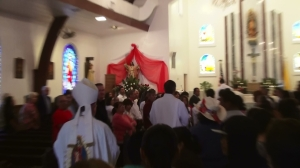 The Bishop moves towards the altar